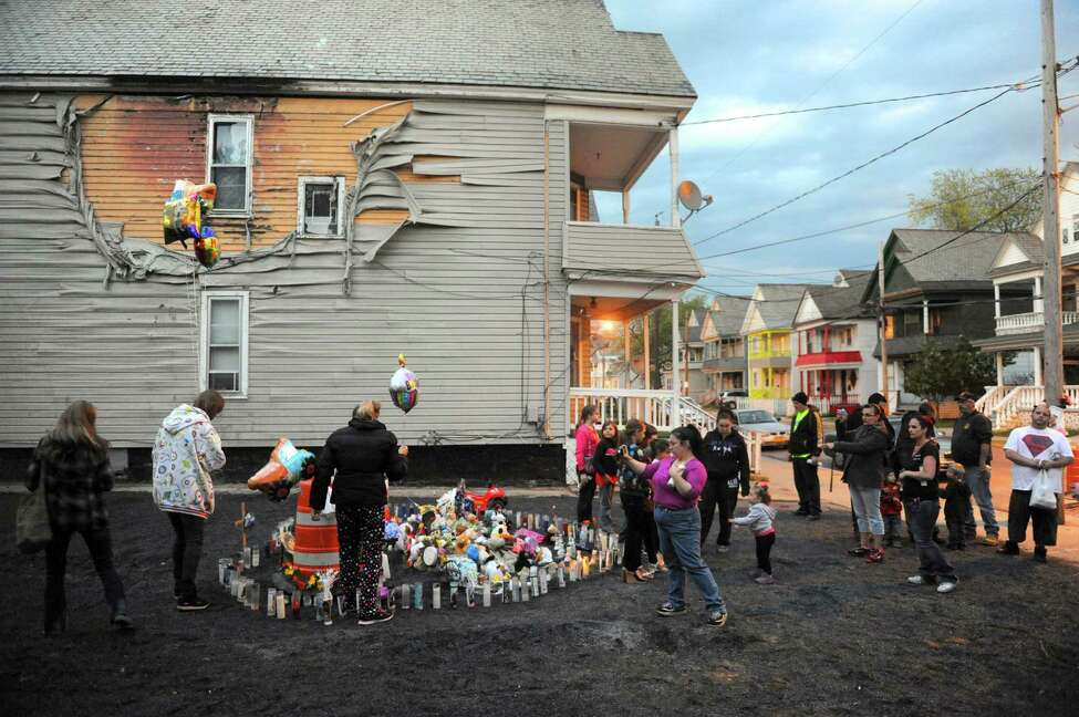 Family, friends and neigbors attend a vigil for Donavan Duell, the youngest victim of Schenectady fatal fire, on what would have his first birthday on Wednesday May 15 2013 in Schenectady, N.Y. He, his father, and three siblings all perished in the May 2 blaze, which authorities say was deliberately set. (Michael P. Farrell/Times Union)
