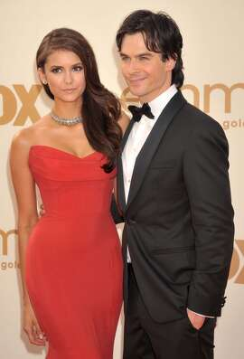"""The Vampire Diaries"" stars Nina Dobrev and Ian Somerhalder are no longer an item, but the former couple went public with their romance in 2011 and have reportedly vowed to remain friends and not let the split affect their work on the drama."