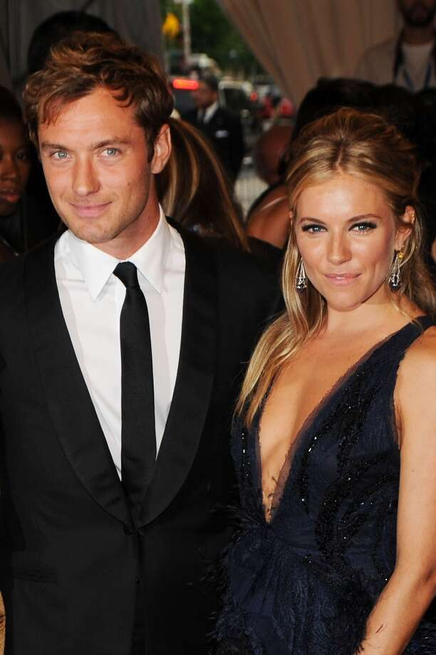 "Jude Law and Sienna Miller were a beautiful couple who met in 2003 on the set of ""Alfie,"" but their relationship couldn't survive his affair with the nanny. Law and Miller split in 2006. Photo: Dimitrios Kambouris, FilmMagic"