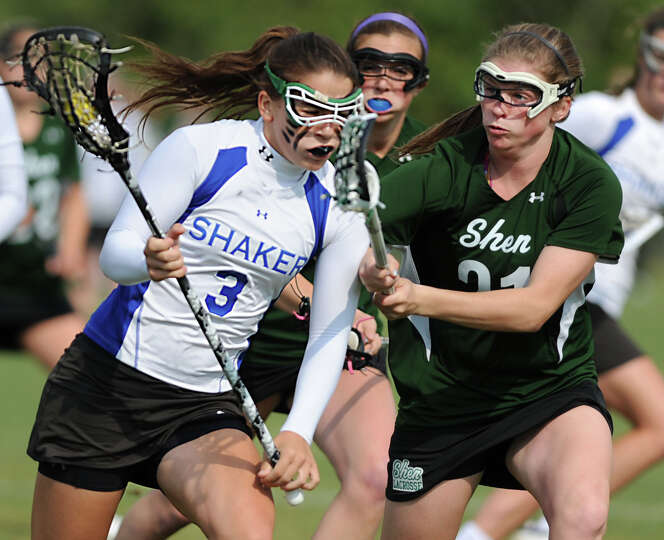 Shaker's Lynn Roberts, left, is defended by Shenendehowa's Kelly Wall during a Section II Class A gi