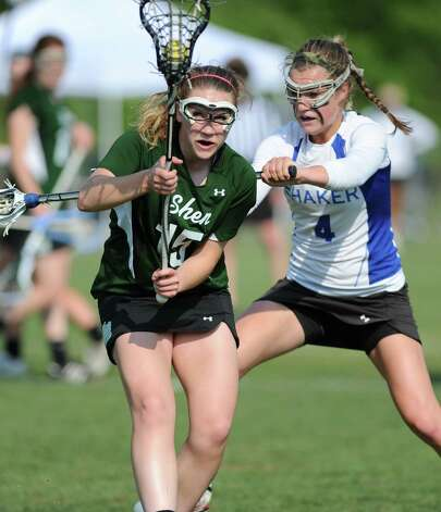 Shenendehowa's Paige Byrne, left, is defended by Shaker's Sarah Cheney during a Section II Class A girls' lacrosse semifinal on Wednesday, May 15, 2013 in Latham, N.Y. (Lori Van Buren / Times Union) Photo: Lori Van Buren / 00022448A
