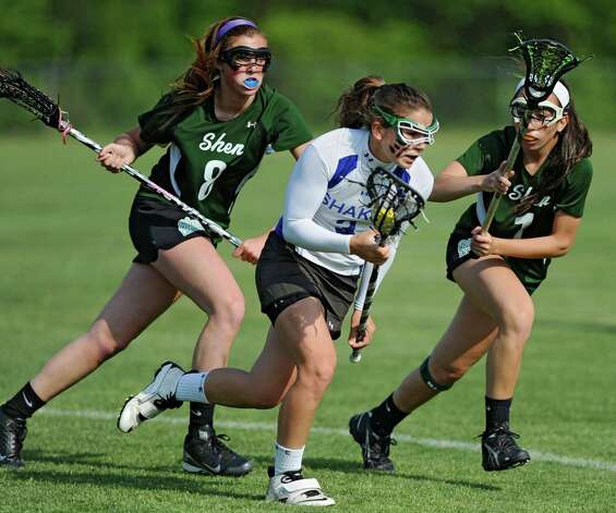 Shaker's Lynn Roberts, center, is defended by Shenendehowa's Rachael Picchi, left, and Katie Kerner during a Section II Class A girls' lacrosse semifinal on Wednesday, May 15, 2013 in Latham, N.Y. (Lori Van Buren / Times Union) Photo: Lori Van Buren / 00022448A