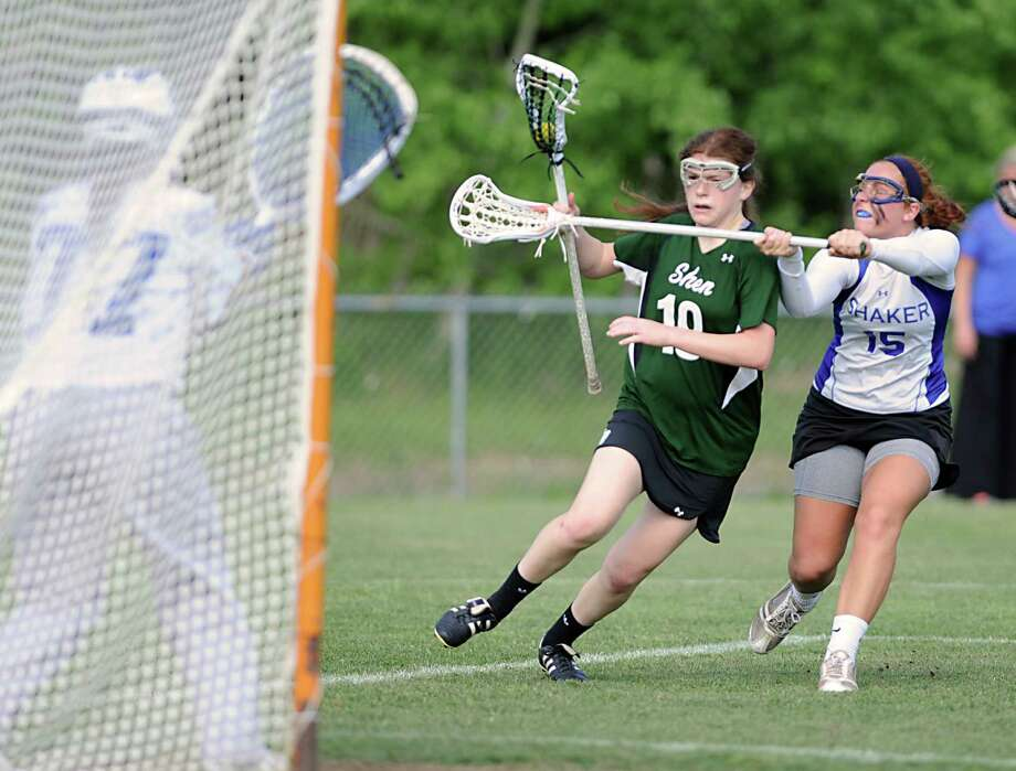 Shenendehowa's Maddie Shea, left, is defended by Shaker's Maddy Smith as she tries to score during a Section II Class A girls' lacrosse semifinal on Wednesday, May 15, 2013 in Latham, N.Y. (Lori Van Buren / Times Union) Photo: Lori Van Buren / 00022448A