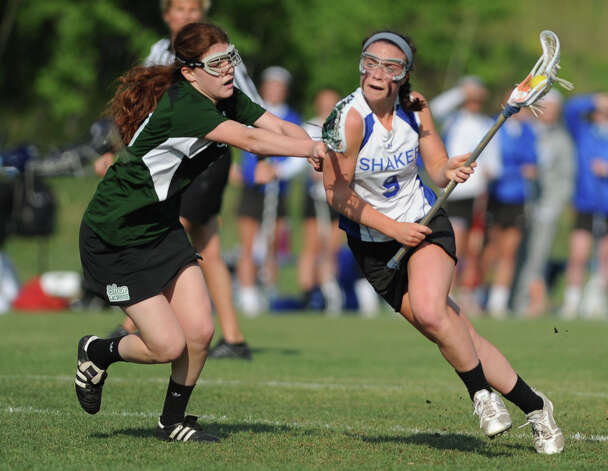 Shenendehowa's Maddie Shea, left, defends Shaker's Julia Lennon but Lennon scores on this play during a Section II Class A girls' lacrosse semifinal on Wednesday, May 15, 2013 in Latham, N.Y. (Lori Van Buren / Times Union) Photo: Lori Van Buren / 00022448A
