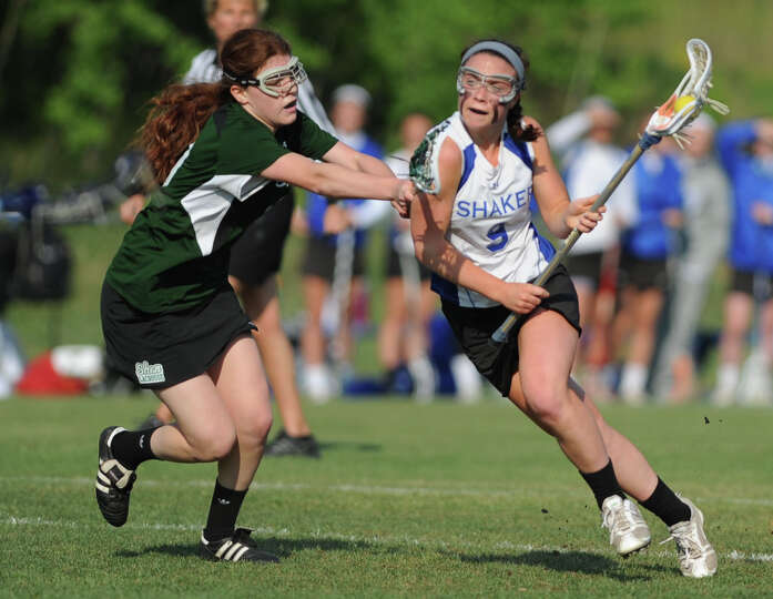 Shenendehowa's Maddie Shea, left, defends Shaker's Julia Lennon but Lennon scores on this play durin