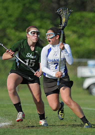 Shenendehowa's Maddie Shea, #15, defends Shaker's Aubrey Conti, #7, during a Section II Class A girl