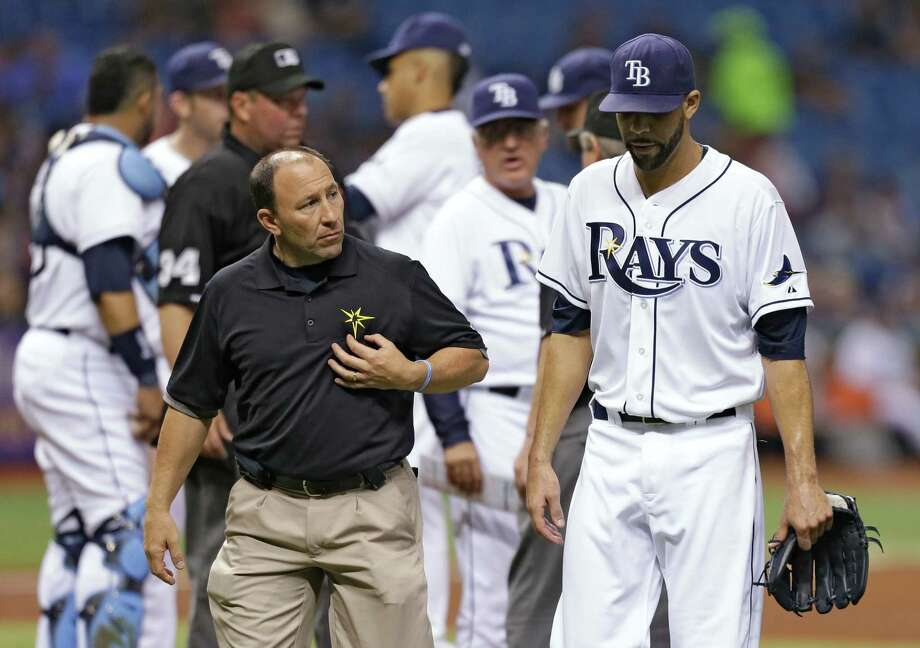 Rays lefthander David Price hangs his head after triceps tightness ended his outing in the third inning. Photo: Chris O'Meara, STR / AP