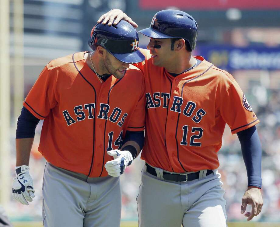 J.D. Martinez (left) is greeted by Carlos Peña after hitting a three-run homer Wednesday in Detroit. Photo: Duane Burleson / Getty Images