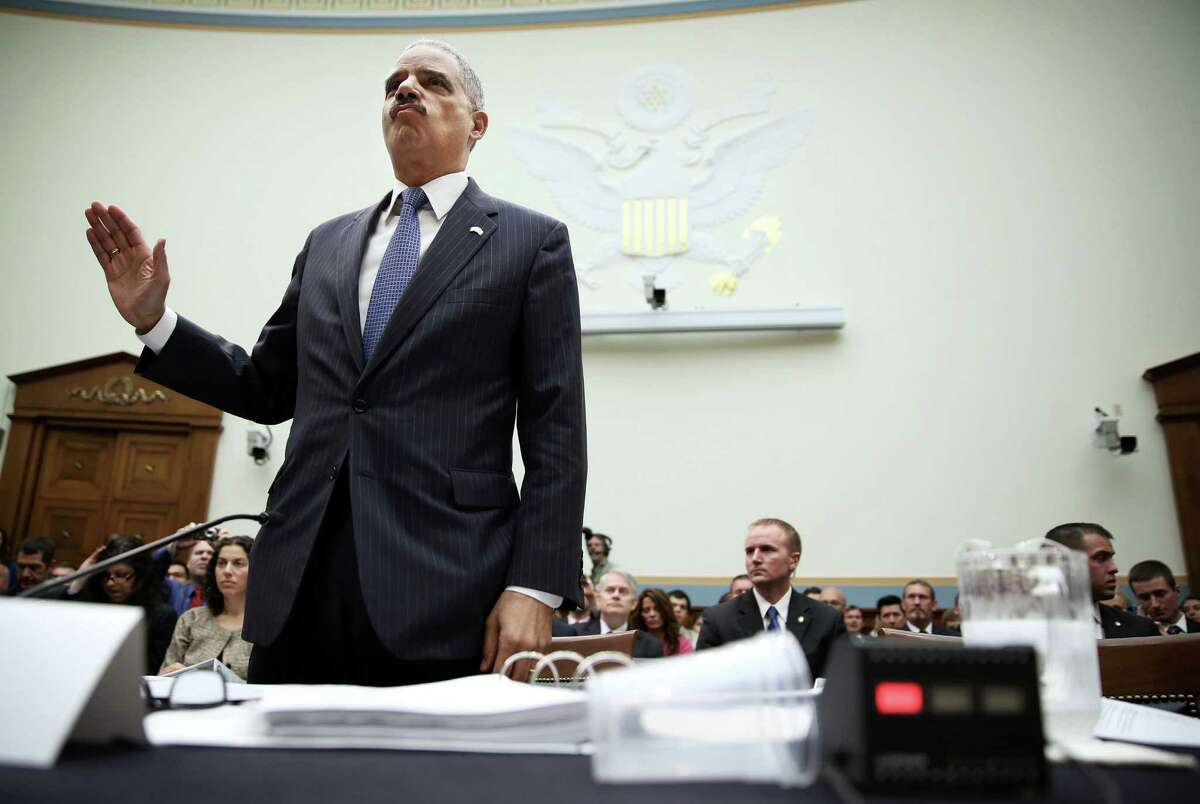 Attorney General Eric Holder is sworn in during a hearing before the House Judiciary Committee on oversight of the Justice Department.