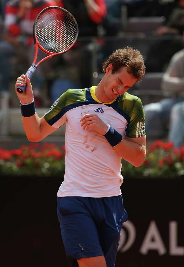 Andy Murray feels the effects of back pain that forced him to withdraw from the Italian Open on Wednesday and has cast doubt on his status for the French Open. Photo: Clive Brunskill, Staff / 2013 Getty Images
