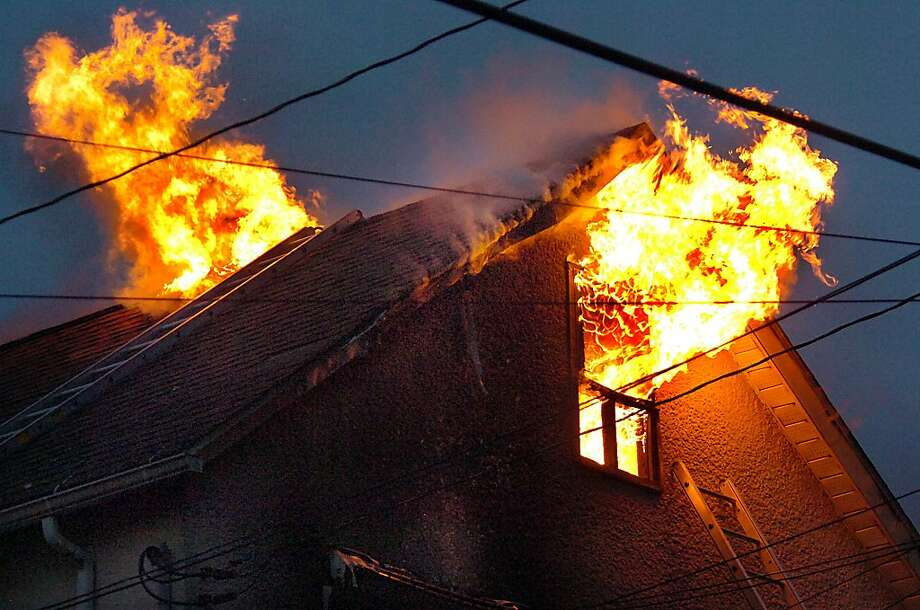 Flames rips through the second story of a home on Loomis Avenue in Taylor, Pa., on Wednesday, May 15, 2013. One person was reported injured.  (AP Photo / The Scranton Times-Tribune, Butch Comegys) WILKES BARRE TIMES-LEADER OUT; MANDATORY CREDIT Photo: Butch Comegys, Associated Press