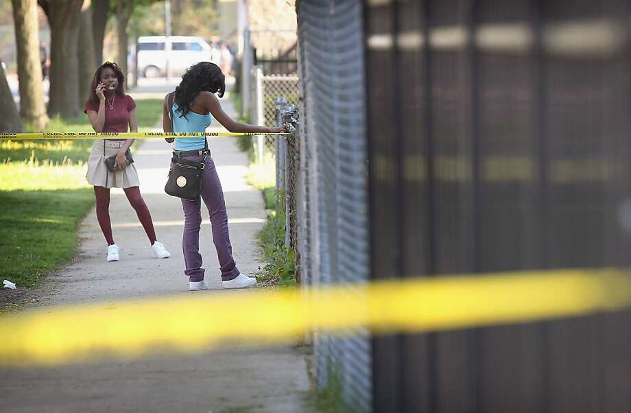 CHICAGO, IL - MAY 14:  Young girls are stopped by crime scene tape as they try to visit a friend near the scene of a shooting where two men were wounded in the South Shore neighborhood on May 14, 2013 in Chicago, Illinois. The shooting was the first of several that left two men dead and 11 others wounded in the city between Monday afternoon and the early hours of Tuesday morning.  (Photo by Scott Olson/Getty Images) Photo: Scott Olson, Getty Images