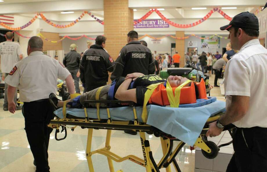 An unidentified injured person is carried to an ambulance in Granbury. (AP Photo/Mike Fuentes) Photo: Mike Fuentes, Associated Press / FR103746 AP