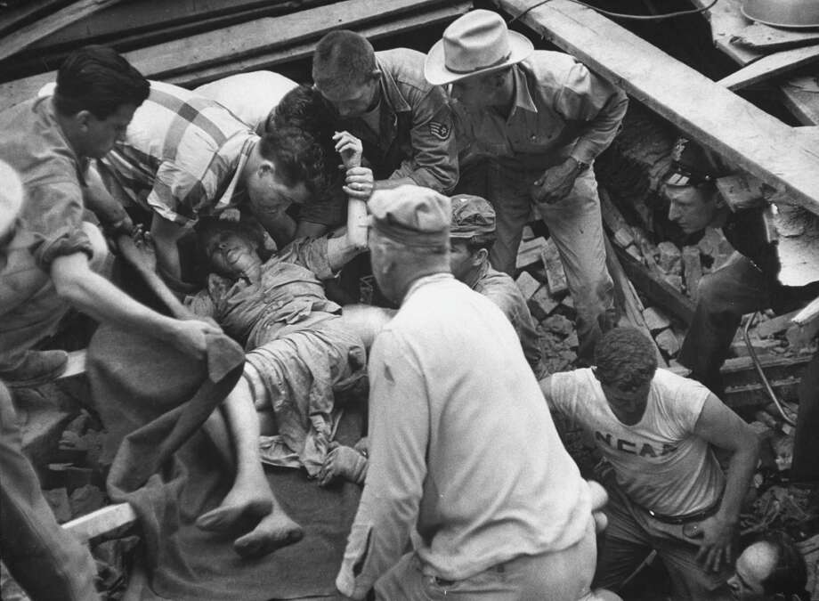 A woman being saved from the wreckage of a tornado in May 1953. Photo: John Dominis, Time Life Pictures / Getty Images / Time Life Pictures