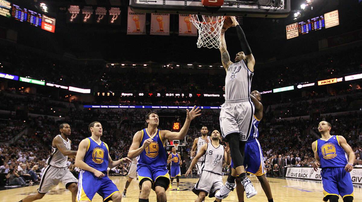 San Antonio Spurs' Danny Green scores during the second half of Game 5 in the NBA Western Conference semifinals against the Golden State Warriors at the AT&T Center, Tuesday, May 14, 2013. The Spurs won 109-91 and lead the series at 3-2.