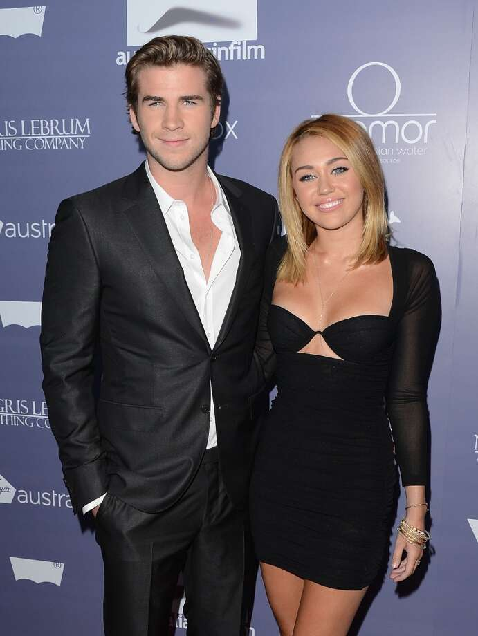 """Liam Hemsworth and Miley Cyrus began dating on the set of """"The Last Song."""" They got engaged, but broke up. Photo: Jason Merritt, Getty Images For AIF"""