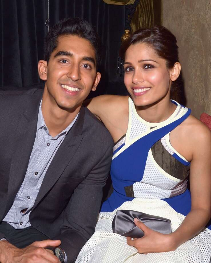 """Slumdog Millionaire"" stars Dev Patel and Freida Pinto met while shooting the Oscar-winning film. They split in 2014. Photo: Lester Cohen, Getty Images For VF"
