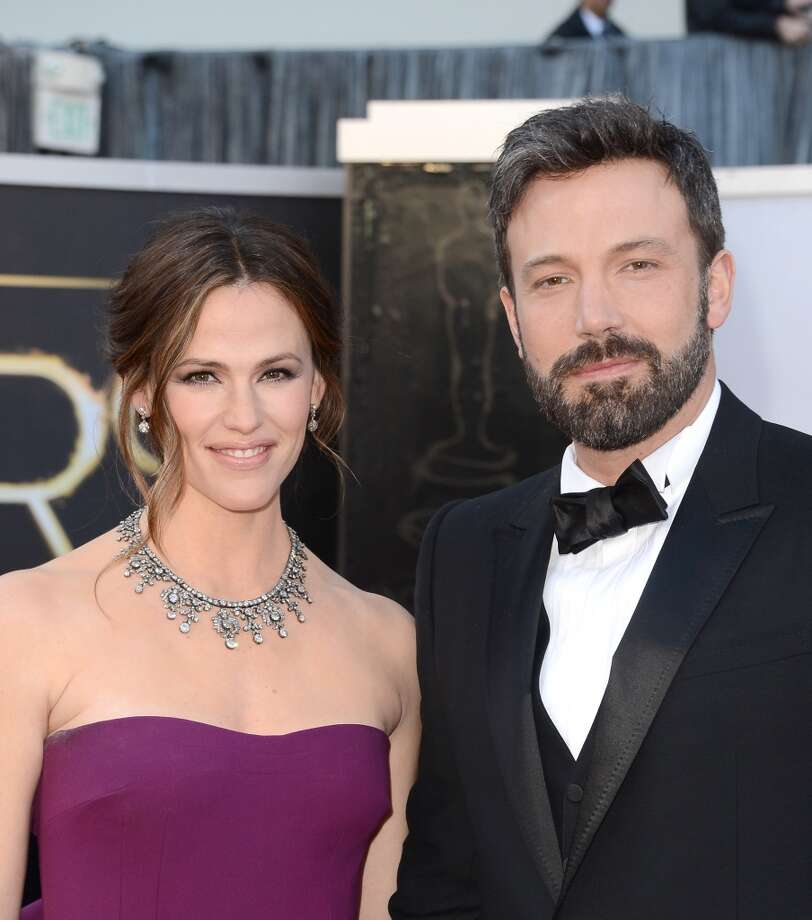 "Jennifer Garner and Ben Affleck met while filming ""Daredevil"" in 2003, though they didn't begin dating until 2004. A 2005 marriage, three kids and one awkward Oscar acceptance speech later, they're still together. Photo: Jason Merritt, Getty Images"
