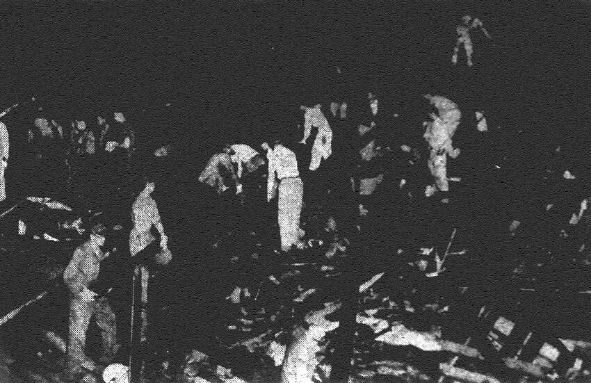 On May 11, 1953, a deadly tornado - an F5 nearly 1/3 of a mile wide - bared down on Waco, killing 114 people and injuring 597. The storm destroyed and damaged thousands of homes, buildings and vehicles. The tornado is tied for the deadliest in Texas history since 1900, with the Goliad tornado of 1902. Workers swarm over the wreckage of the R.T. Dennis Building, searching for victims of the Waco tornado. Powerful searchlights helped speed the rescue attempts. Published in the San Antonio Express May 13, 1953.