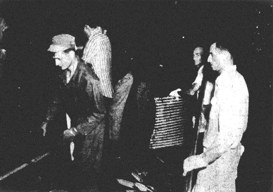 Hundreds of volunteers, like these above, labored through the night in search of victims. Their labors were lighted by searchlights as they looked for storm victims Thursday, downtown Waco was hardest hit. Published in the San Antonio News May 14, 1953. Photo: File Photo
