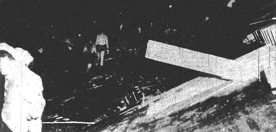 An old-fashioned relay team worked long and hard to clear away debris at this location in Waco. It was the only means at hand to clear path for rescuers of persons trapped beneath crumpled buildings. Published in the San Antonio News May 14, 1953. Photo: File Photo