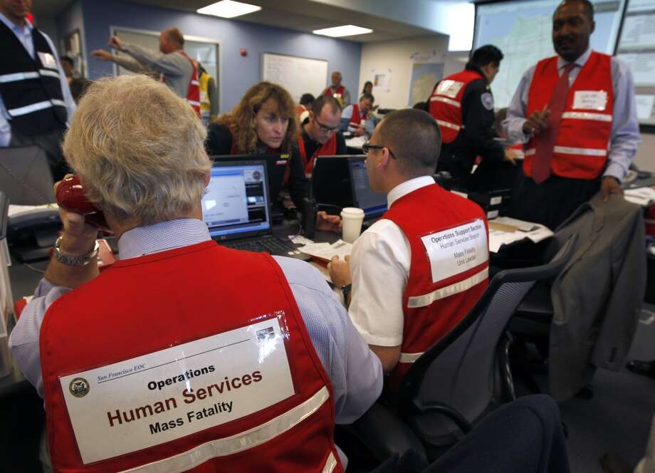 Bill Ahern (left) and Christopher Wiranek keep track of casualties during a simulated disaster drill inside the Emergency Operations Center after a projected 7.8 magnitude earthquake in San Francisco, Calif. on Wednesday, May 15, 2013.