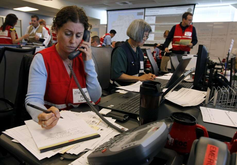 Ellen Levin, from the city's PUC, monitors water quality during a simulated disaster drill at the emergency Operations Center after a projected 7.8 magnitude earthquake in San Francisco, Calif. on Wednesday, May 15, 2013.
