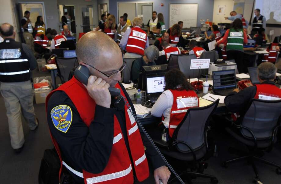 Police Lt. Simon Silverman fields a call about a gas leak at the Hall of Justice during a simulated disaster drill at the Emergency Operations Center after a projected 7.8 magnitude earthquake in San Francisco, Calif. on Wednesday, May 15, 2013.
