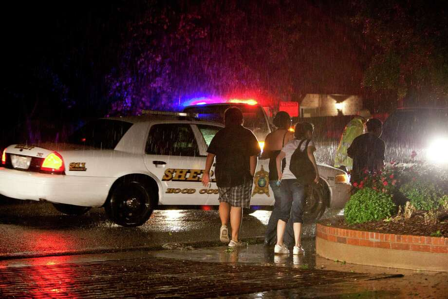 Residents in the Granbury, Texas, neighborhood of Rancho Brazos are evacuated after storms on Wednesday, May 15, 2013. (Joyce Marshall/Fort Worth Star-Telegram/MCT) Photo: Joyce Marshall, McClatchy-Tribune News Service / Fort Worth Star-Telegram