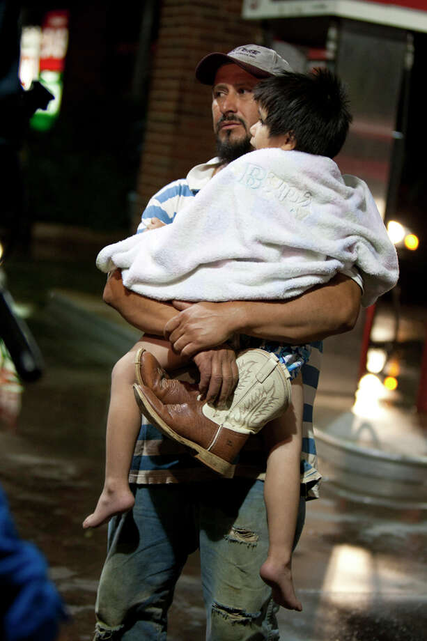 Jose and Antonio Angudo after being evacuated from the Granbury, Texas, neighborhood of Rancho Brazos that was blasted by storms on Wednesday, May 15, 2013. Photo: Joyce Marshall, . / Fort Worth Star-Telegram