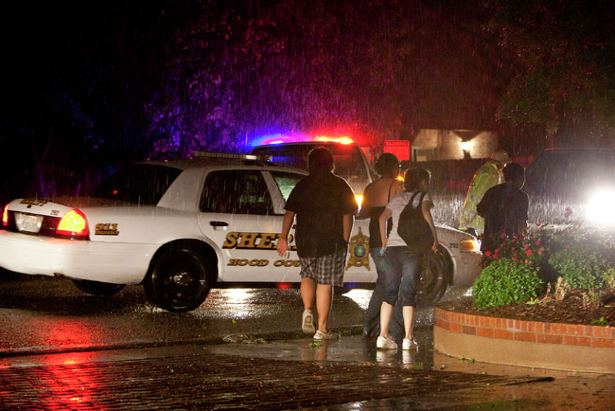 Residents in the Granbury, Texas, neighborhood of Rancho Brazos are evacuated after storms on Wednesday, May 15, 2013.
