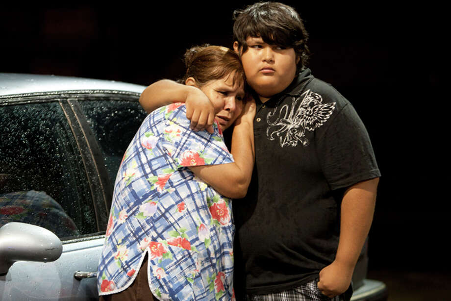 Eva Zapata, left, waits with family member Dario Segura for news of her children, who live in the Granbury, Texas, neighborhood of Rancho Brazos that was evacuated after storms on Wednesday, May 15, 2013. Photo: Joyce Marshall, . / Fort Worth Star-Telegram