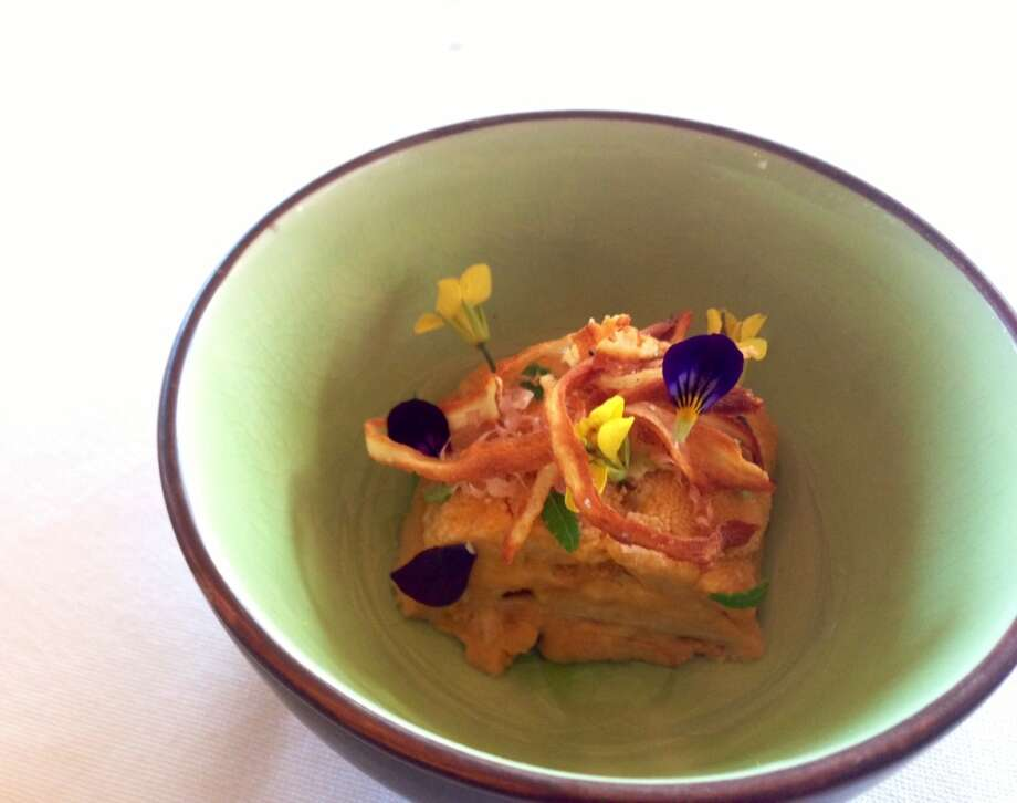 Uni with kombu broth, fried ribboons of salsify, purple viola, yellow mustard flowers and wasabi