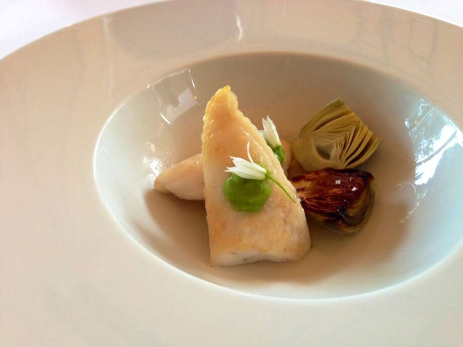 John Dory with braised and smoked baby artichokes,greengarlic and kombu broth