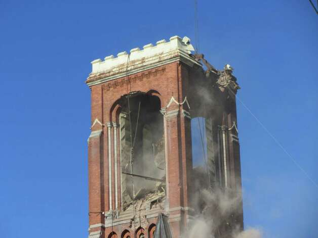 A crane pulls out chunks of St. Patrick's Church tower in Watervliet on Thursday, May 16, 2013. (Bob Gardinier / Times Union)