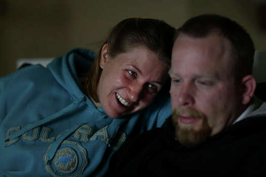 Anna Moore with with her husband, Jessie. After reporting a sexual assault in the Army, Anna did not receive proper mental health counseling and eventually became suicidal. Photo: Lisa Krantz / San Antonio Express-News