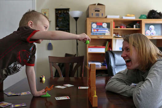 Anna Moore plays with son Garrett, 4, at their home in Colorado. Photo: Lisa Krantz