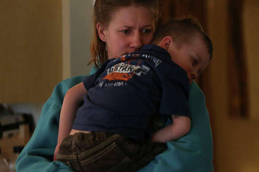 Anna Moore holds her son, Garrett, 4, at their home in Colorado Springs, Colo. Photo: Lisa Krantz