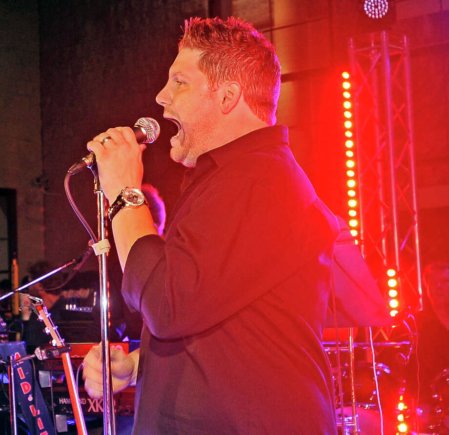 American Idol participant Michael Sarver makes a guest appearance to sing with the Mid Life Crisis band at the Gift of Life Champagne and Ribs 2013 event at Cowboy Harley-Davidson dealership in Beaumont on Thursday, April 18, 2013. Photo taken: Randy Edwards/The Enterprise Photo: Randy Edwards