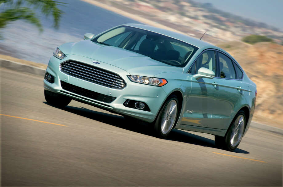 """Ford Fusion  What Car Connection said: """"The 2011 Ford Fusion comes in a few finely developed flavors; Sport, Hybrid and base are a few of the best tastes. """" Photo: File / Ford"""