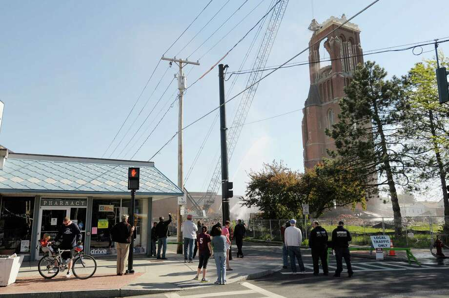 People gather to watch as the demolition of the bell tower at the former St. Patrick's Church began on Thursday, May 16, 2013 in Watervliet, NY.    (Paul Buckowski / Times Union) Photo: Paul Buckowski