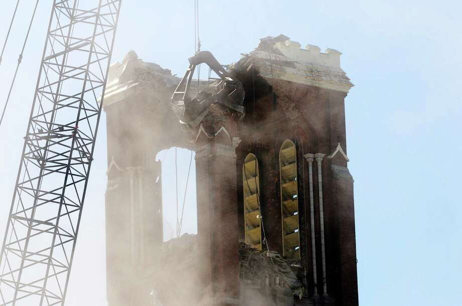 A large crane with a clamshell bucket comes down on a part of the church as the demolition of the bell tower at the former St. Patrick's Church began on Thursday, May 16, 2013 in Watervliet, NY.    (Paul Buckowski / Times Union) Photo: Paul Buckowski