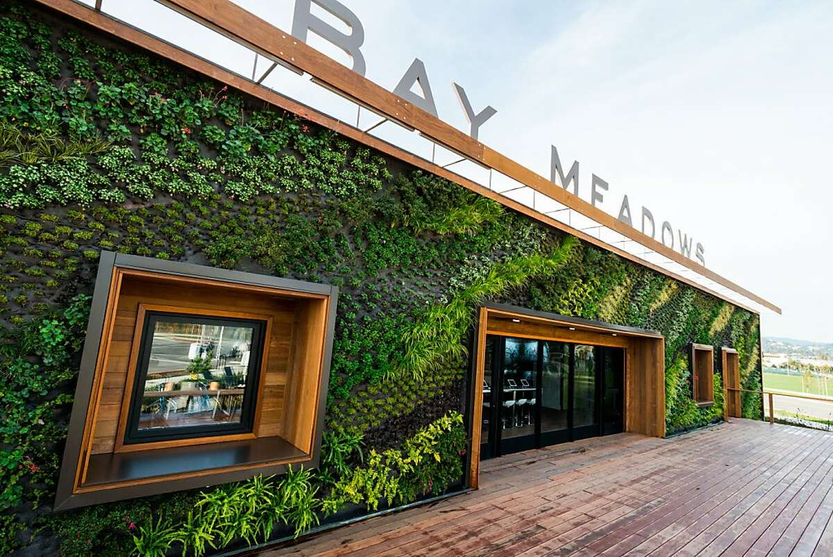 A living wall decorates the exterior of the Welcome Center, and will be incorporated into the new community.