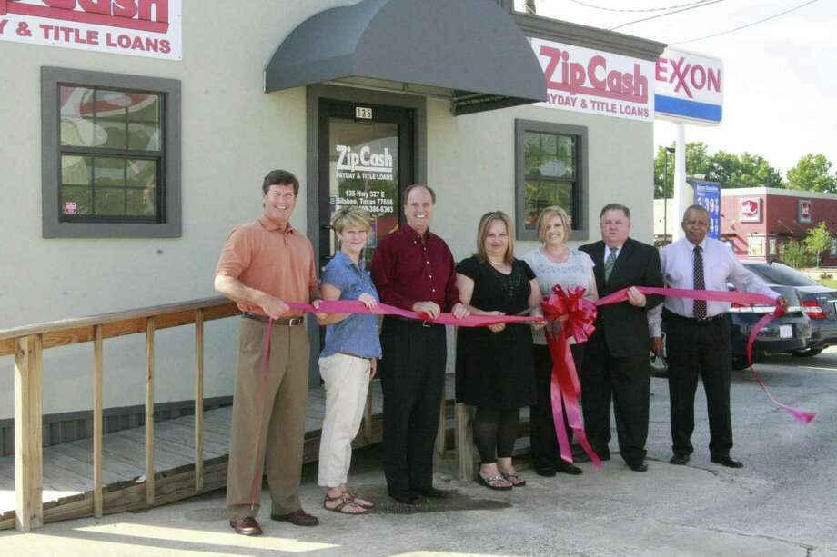 Zip Cash, 135 U.S. 327 East, Silsbee. (Left to right) Mic Cowart, Chamber Director; Stacy Garner, Chamber Director; Jim C. Willis, Executive Director Silsbee Chamber; Brenda Lilly, Office Manager; Jaime Ogordowicz, Woodville Office Manager; Steve Cooper, President Silsbee Chamber; and Walter Land, Chamber Director. Photo: Handout