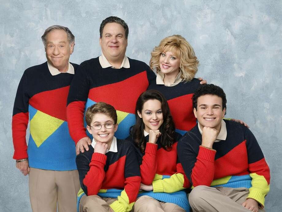 "THE GOLDBERGS - ""The Goldbergs"" stars Wendi McLendon-Covey (""Bridesmaids"") as Beverly, Jeff Garlin (""Curb Your Enthusiasm"") as Murray, George Segal (""Don't Shoot Me"") as Pops, Hayley Orrantia (""The X Factor"") as Erica, Sean Giambrone as Adam and Troy Gentile (""Good Luck Chuck"") as Barry. ""The Goldbergs"" was written and executive-produced by Adam F. Goldberg (""Breaking In,"" ""Fanboys"") and also executive produced by Doug Robinson. The pilot was directed by Seth Gordon (""Identity Thief,"" ""Horrible Bosses""). ""The Goldbergs"" is from Adam Sandler's production company, Happy Madison, and is produced by Sony Pictures Television.  (ABC/Craig Sjodin) STANDING: GEORGE SEGAL, JEFF GARLIN, WENDI MCLENDON-COVEY;   SEATED: SEAN GIAMBRONE, HAYLEY ORRANTIA, TROY GENTILE Photo: Craig Sjodin, ABC / © 2013 American Broadcasting Companies, Inc. All rights reserved."