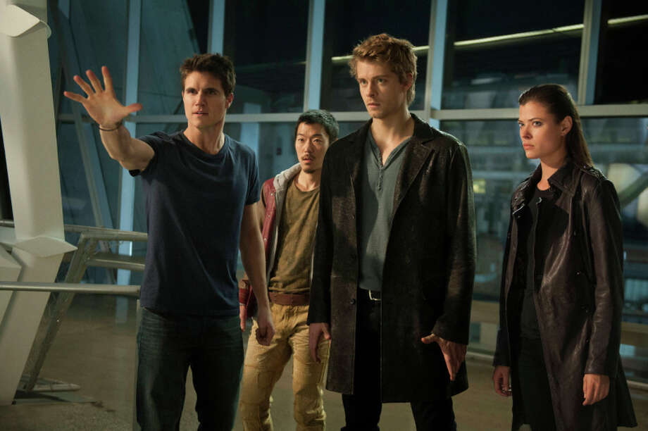 "The Tomorrow People -- ""Pilot"" -- Image Number: TP100A_0453.jpg --Pictured (L-R): Robbie Amell as Stephen, Aaron Woo as Russell, Luke Mitchell as John and Peyton List as Cara -- Photo: Barbara Nitke/The CW -- © 2013 The CW Network, LLC.  All rights reserved. Photo: BARBARA NITKE / © 2013 The CW Network, LLC. All rights reserved."