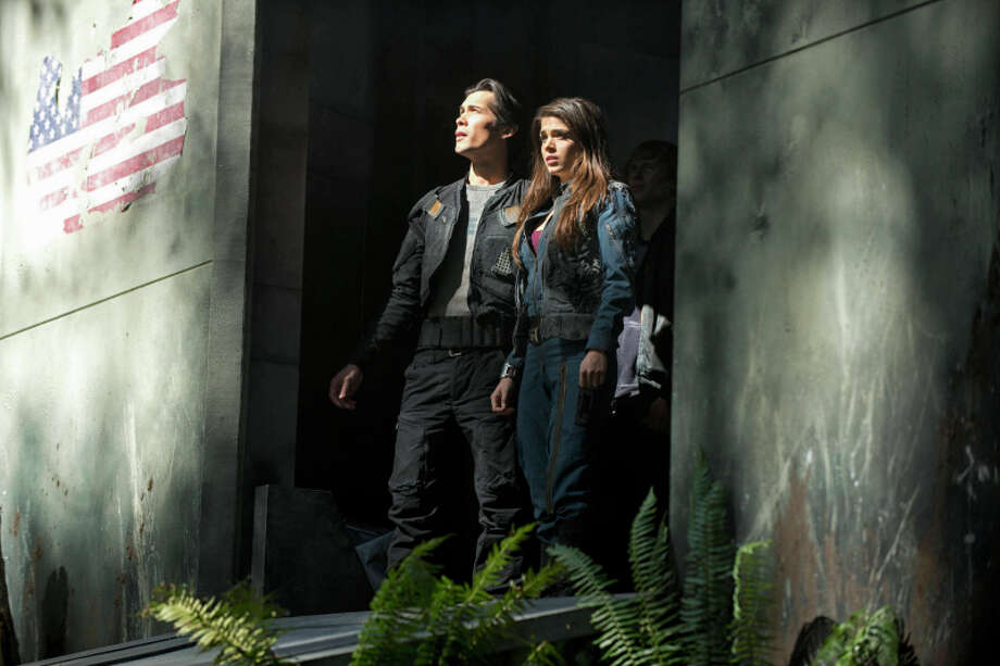 "The 100 --  ""Pilot"" -- Image: HU101c_16747 -- Pictured (L-R): Bob Morley as Bellamy and Marie Avgeropoulos as Octavia -- Photo: Cate Cameron/The CW -- © 2013 The CW Network. All Rights Reserved. Photo: Cate Cameron, Cate Cameron/The CW / © 2013 THE CW NETWORK, LLC. ALL RIGHTS RESERVED."