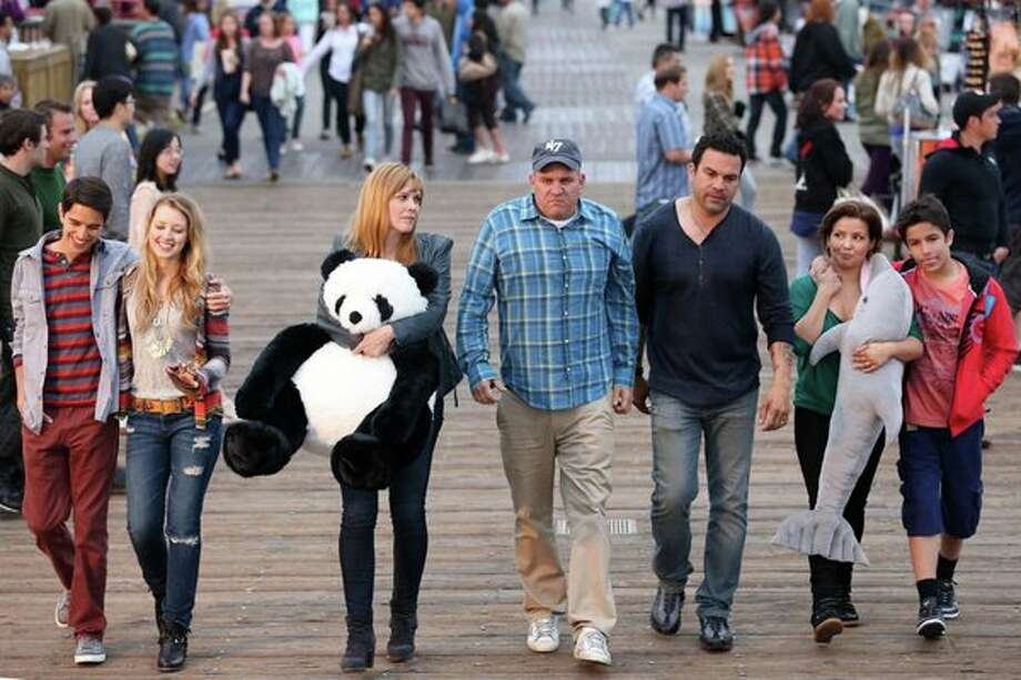 "WELCOME TO THE FAMILY -- ""Pilot"" -- Pictured: (l-r)  Joey Haro as Junior Hernandez , Ella Rae Peck as Molly Yoder, Mary McCormack as Caroline Yoder, Mike O'Malley as Dan Yoder, Ricardo Chavira as Miguel Hernandez, Justina Machado as Lisette Hernandez, Aramis Knight as Demetrio Hernandez -- Photo: NBC, Adam Taylor/NBC / 2013 NBCUniversal Media, LLC"