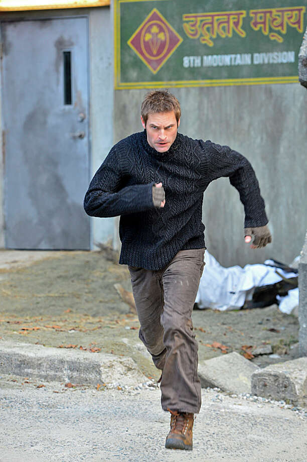 """Pilot"" -- CBS'™s new dramatic thriller INTELLIGENCE stars Josh Holloway as a high tech intelligence operative enhanced with a super-computer microchip in his brain.   INTELLIGENCE will premiere this winter, Mondays (10:00-11:00 PM ET/PT) on the CBS Television Network.  Photo: Chris Helcermanas-Benge/CBS © 2013 CBS Broadcasting, Inc. All Rights Reserved. Photo: Chris Helcermanas-Benge / Ã?© 2013 CBS Broadcasting, Inc. All Rights Reserved."