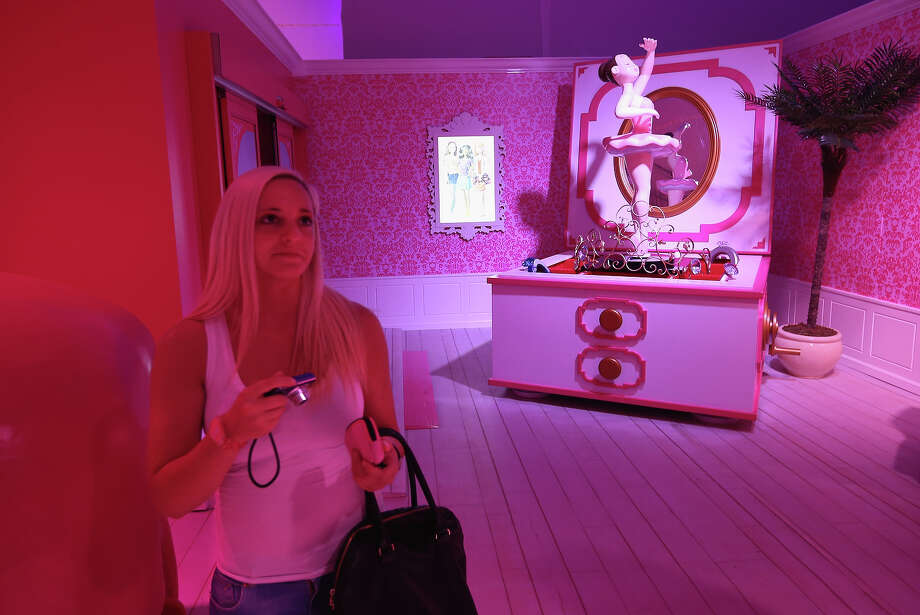 A visitor from Austria walks through Barbie's bedroom at the Barbie Dreamhouse Experience on May 16, 2013 in Berlin, Germany. The Barbie Dreamhouse is a life-sized house full of Barbie fashion, furniture and accessories and will be open to the public until August 25 before it moves on to other cities in Europe. Photo: Sean Gallup, Getty Images / 2013 Getty Images
